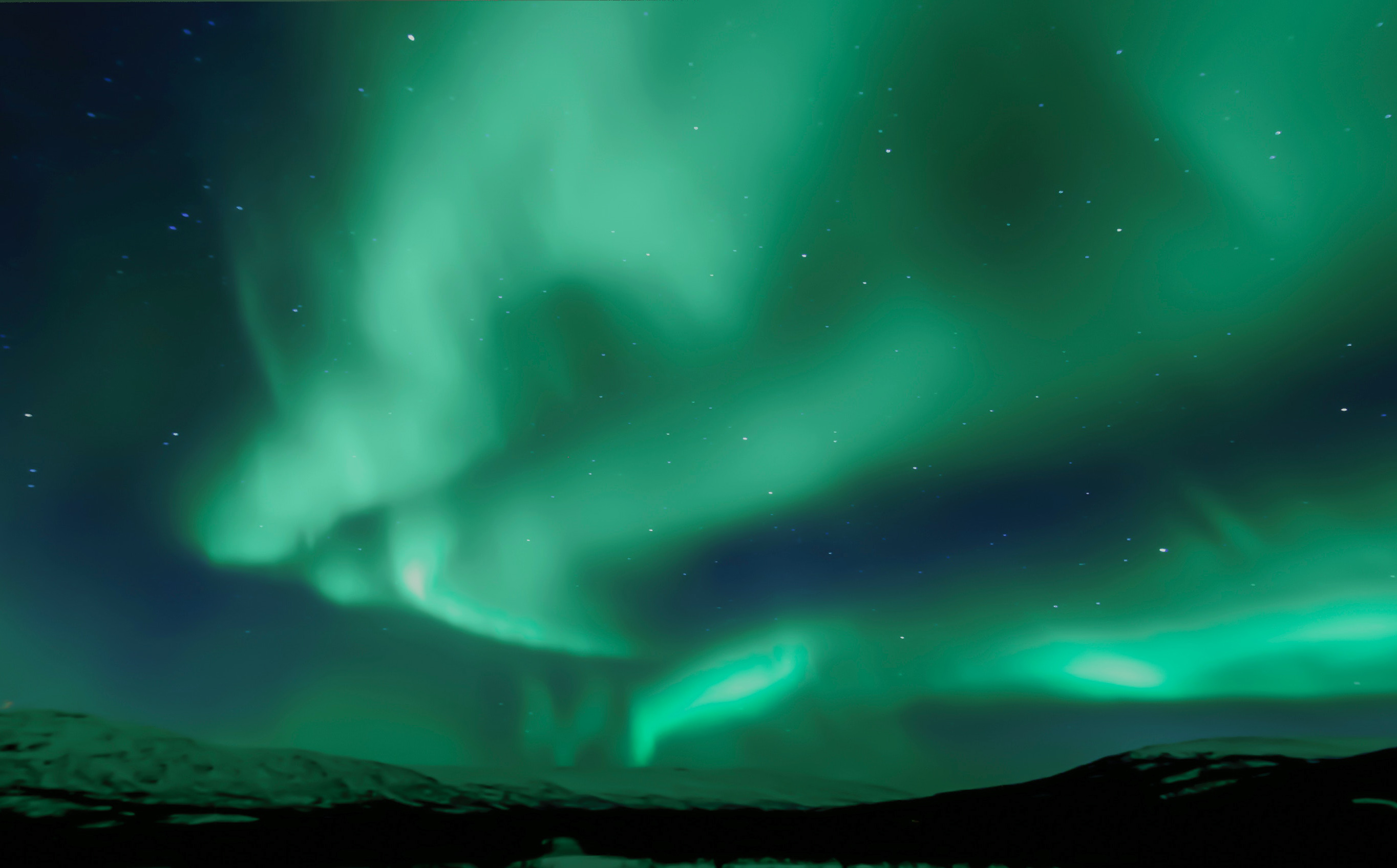 The northern lights over a mountain range